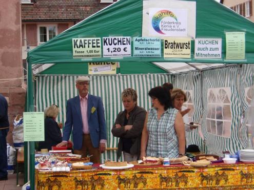 Society members selling coffee, cake, German sausages, and non-alcoholic drinks.